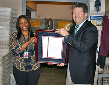 PMG Pat Donahoe presents Teneisha Black with her plaque as new Postmaster of Venetia, PA.