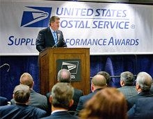 PMG Pat Donahoe speaks to suppliers during an awards ceremony honoring their work. Click on the image to view a larger version